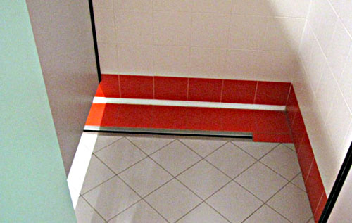 Floor drain, inspection cover and channel drain in stainless steel with slit for locker room showers of sports club